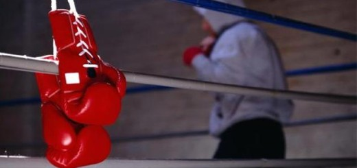 Boxing Gloves Hanging on Ropes
