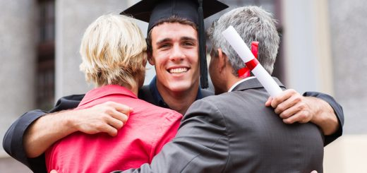 graduate hugging his parents at graduation