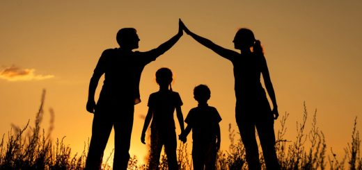 47223108 - happy family standing in the park at the sunset time.  concept of friendly family.